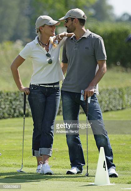 Actress Sophie Schuett and her new partner Felix Seitz attend the BMW Adlon Golf Cup 2010 at Golf and Country Club Seddiner See on August 21 2010 in...