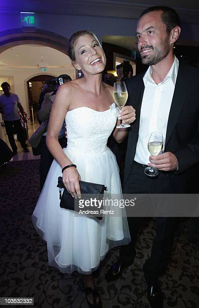 Actress Sophie Schuett and her new partner Felix Seitz attend the BMW Adlon Golf Cup 2010 party at Adlon Hotel on August 21 2010 in Michendorf near...
