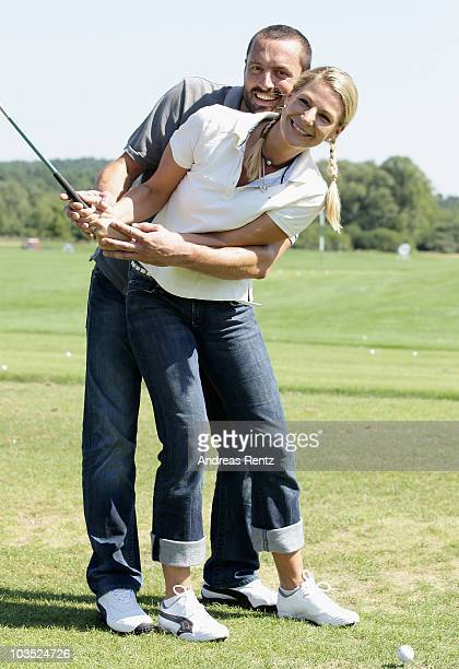 Actress Sophie Schuett and her partner Felix Seitz attend the BMW Adlon Golf Cup 2010 on August 21 2010 in Michendorf near Berlin Germany