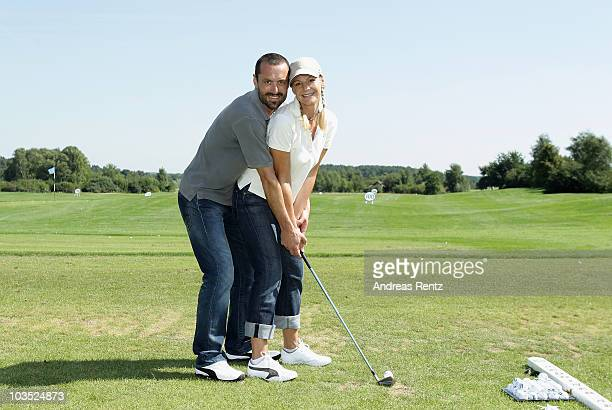 Actress Sophie Schuett and her partner Felix Seitz attend the BMW Adlon Golf Cup at Golf and Country Club Seddiner See 2010 on August 21 2010 in...