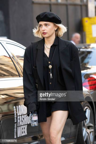 Actress Sophie Simnett wears a Bite London jacket, shirt and shorts and black beret during London Fashion Week September 2019 on September 13, 2019...