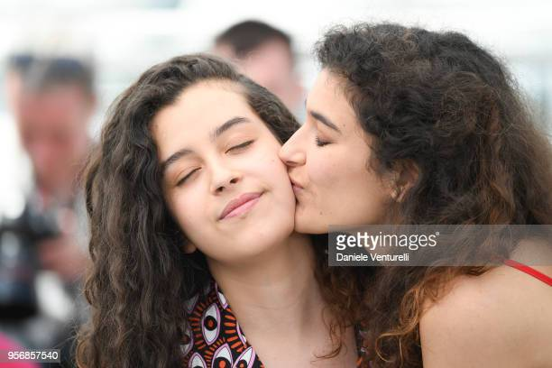 Actress Souad Arsane is kissed by Inas Chanti at the photocall for 'A Genoux Les Gars' photocall during the 71st annual Cannes Film Festival at...