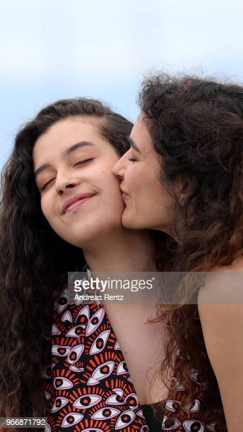 Actress Souad Arsane is kissed by Inas Chanti at the photocall for 'A Genoux Les Gars' during the 71st annual Cannes Film Festival at Palais des...