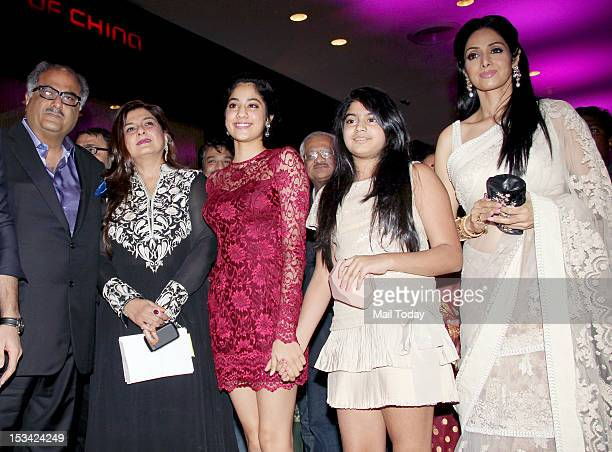 Actress Sridevi with her daughters Jhanvi Kapoor Khushi Kapoor and husband Boney Kapoor during the premiere of the movie 'English Vinglish' held at...