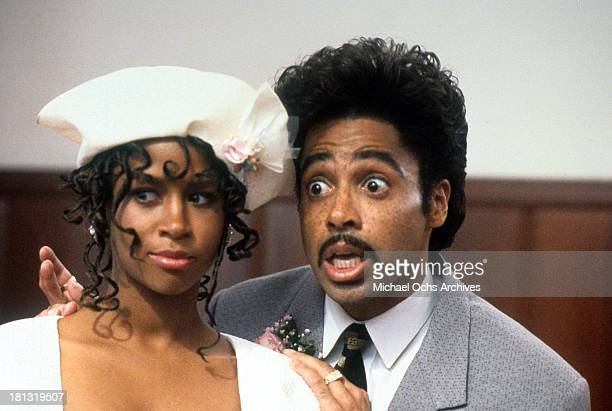Actress Stacey Dash and actor Morris Day on set of the Warner Bros movie ' Moving' in 1988