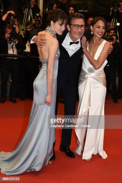 Actress Stacy Martin director Michel Hazanavicius and actress Berenice Bejo attend the 'Redoubtable ' screening during the 70th annual Cannes Film...