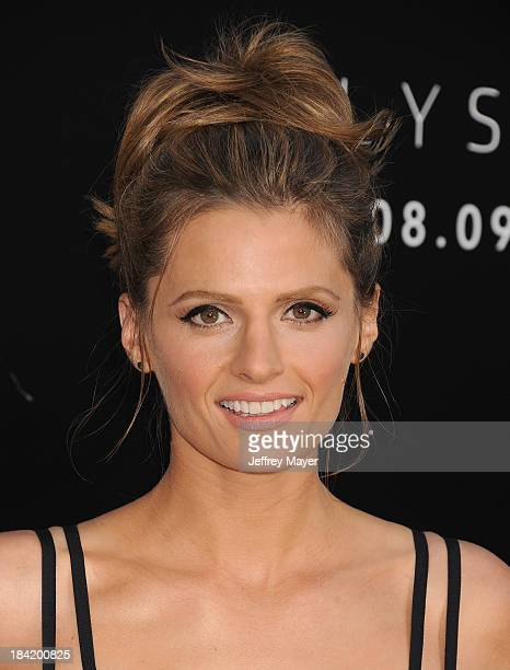 Actress Stana Katic arrives at the Los Angeles premiere of 'Elysium' at Regency Village Theatre on August 7 2013 in Westwood California