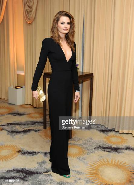 Actress Stana Katic attends the 100th anniversary celebration of the Beverly Hills Hotel Bungalows supporting the Motion Picture Television Fund and...