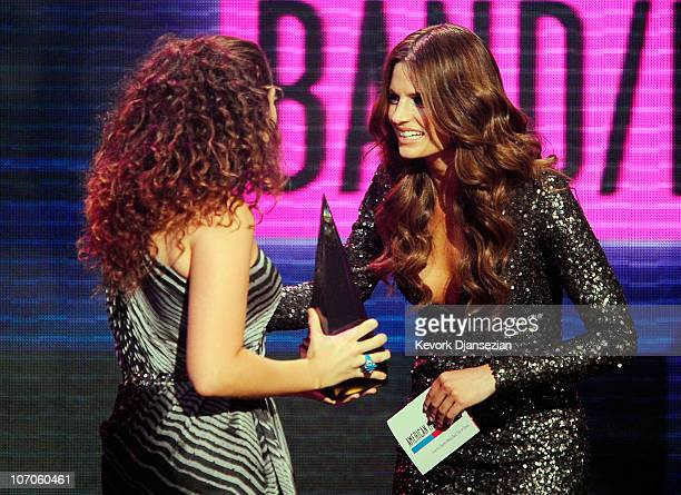 Actress Stana Katic presents singer Hillary Scott of the band Lady Antebellum the Country Music Favorite Band Duo or Group award onstage during the...
