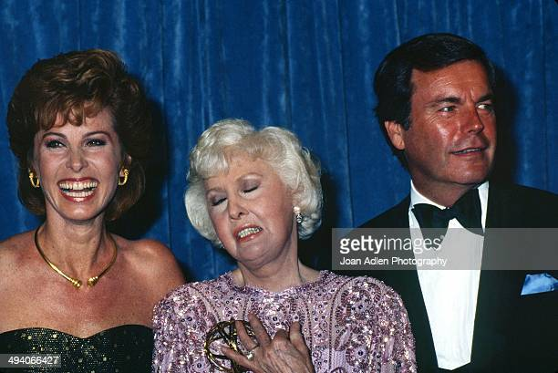 Actress Stefanie Powers and actor Robert Wagner present actress Barbara Stanwyck with award for Outstanding Lead Actress in a Limited Series or...
