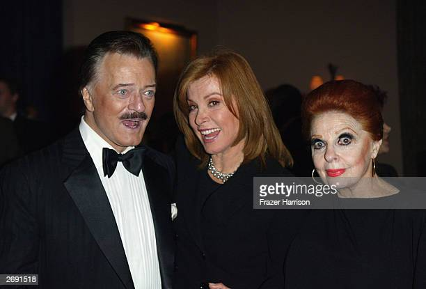 Actress Stefanie Powers poses with Robert Goulet and Carole Cook at the post party for the William Holden Wildlife Foundation's 20th Anniversary...