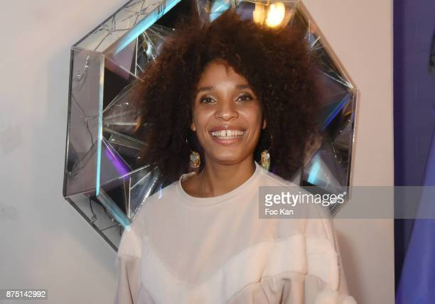 Actress Stefi Celma poses with a work of street artist Le Diamataire during the 'Second Life' By Le Diamantaire Private Exhibition Preview at Atelier...