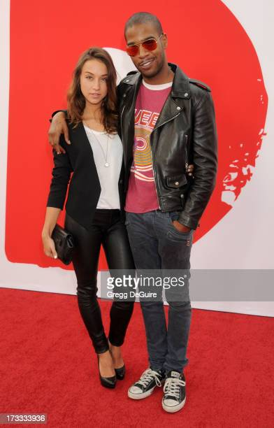 Actress Stella Maeve and recording artist Kid Cudi arrive at the Los Angeles premiere of Red 2 at Westwood Village on July 11 2013 in Los Angeles...