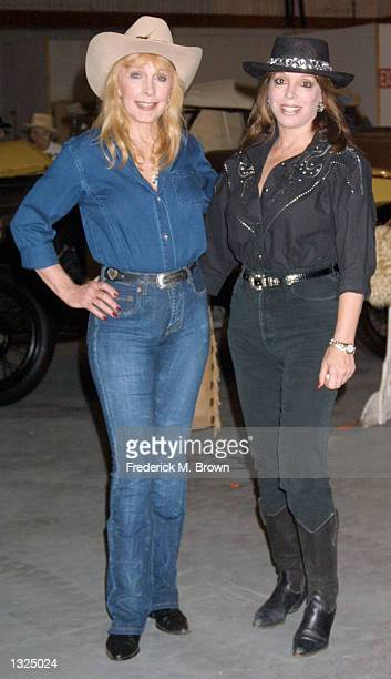 Actress Stella Stevens left and boxing promoter Jackie Kallen arrive at the Country Western Barbecue to benefit abused women June 23 2001 in Studio...
