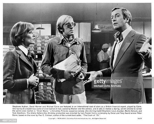 Actress Stephane Audran actors David Warner and Michael Caine on set the movie Silver Bears circa 1977