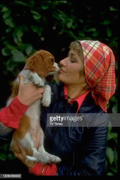 Actress Stephanie Beacham photographed with a King Charles Spaniel, circa 1973.