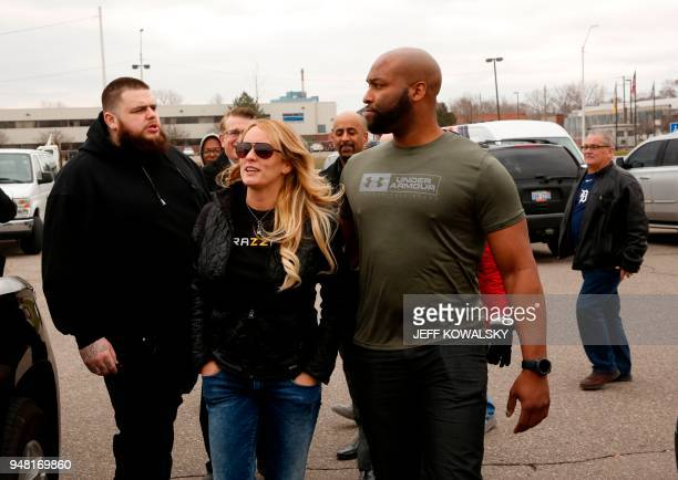 Actress Stephanie Clifford who uses the stage name Stormy Daniels leaves the Detroit Police Department's 4th Precinct flanked by her body guards...