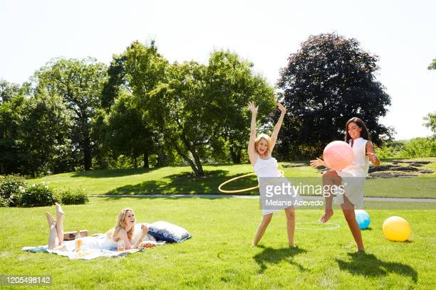 Actress Stephanie March comedian Ali Wentworth and cookbook author Katie Lee are photographed for Hamptons Magazine on June 6 2014 in Hampton New York