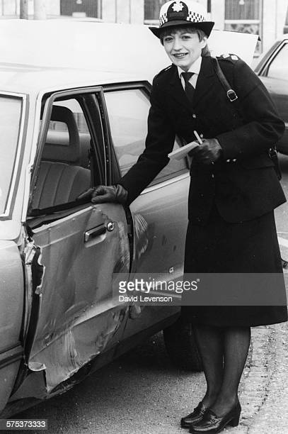 Actress Stephanie Turner pictured next to a smashed up car wearing a police uniform promoting her new BBC television show 'Juliet Bravo' London March...