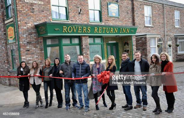 Actress Sue Nicholls cuts a ribbon with Coronation Street cast members to open the Coronation Street set on November 29 2013 in Manchester England