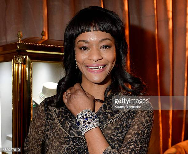Actress Sufe Bradshaw poses the $5 million sapphire and diamonds cuff from Graff jewelry during 21st Annual SAG Awards Behind The Scenes At The...