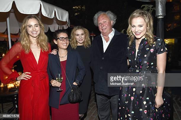 Actress Suki Waterhouse guest actress Elizabeth Olsen Vanity Fair Editor In Chief Graydon Carter and TV personality Poppy Jamie attend VANITY FAIR...