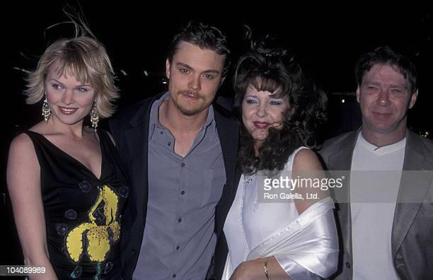 Actress Sunny Mabrey actor Clayne Crawford and her parents attend the premiere of 'A Walk To Remember' on January 23 2002 at Grauman Chinese Theater...