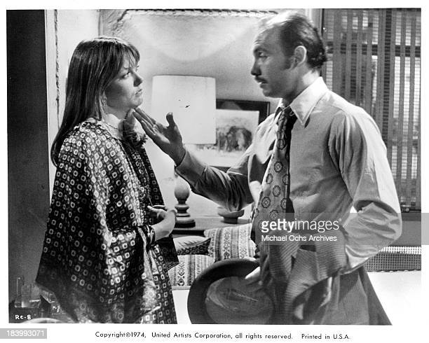 Actress Susan Blakely and actor Hector Elizondo on set of the United Artists movie 'Report to the Commissioner' in 1975