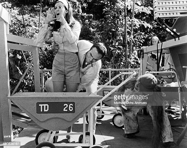 Actress Susan Clark and actor Burt Reynolds in a scene from the movie Skullduggery circa 1970