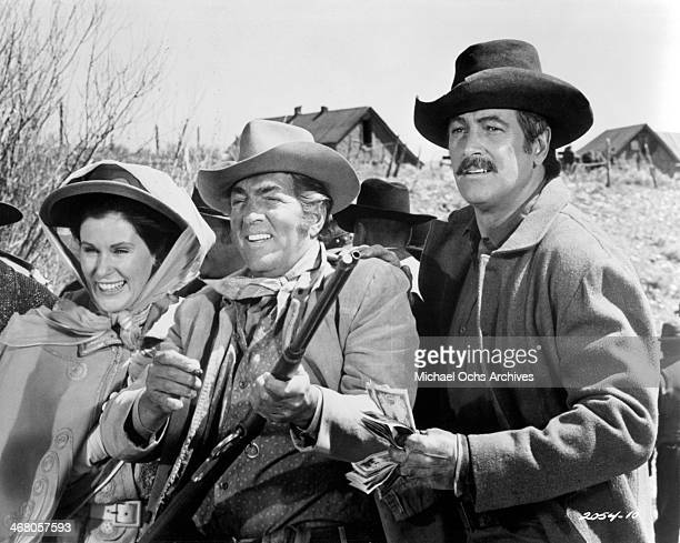 Actress Susan Clark with actors Dean Martin and Rock Hudson on set of the movie Showdown circa 1973