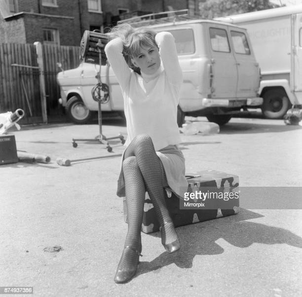Actress Susan George, pictured on the film set during a filming break in Tooting High Street, London. She is filming at a pub called The Castle....