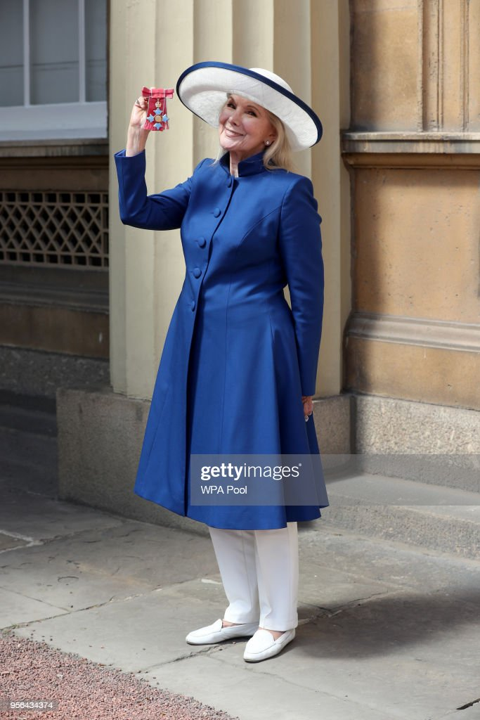 Actress Susan Hampshire poses with the CBE (Commander of the Order of the British Empire)received during the Investiture ceremony at Buckingham Palace on May 9, 2018 in London England