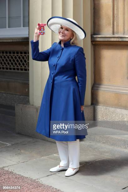 Actress Susan Hampshire poses with the CBE received during the Investiture ceremony at Buckingham Palace on May 9 2018 in London England
