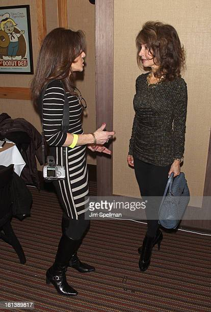 Actress Susan Lucci and a fan attend the Spontaneous Construction premiere at Guys American Kitchen Bar on February 10 2013 in New York City