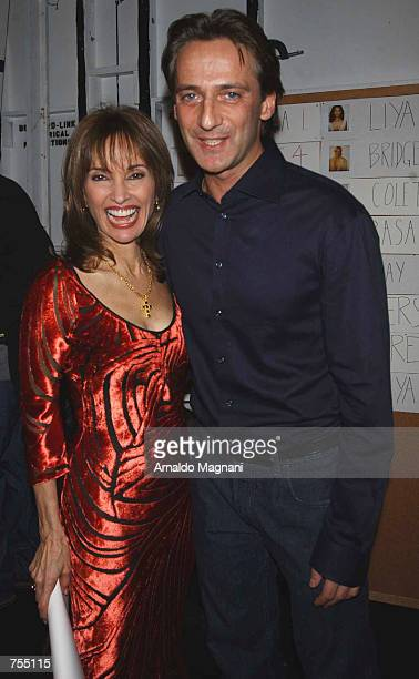 Actress Susan Lucci and designer Luca pose at the Luca Luca Fashion Show February 12 2002 in New York City