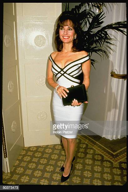 Actress Susan Lucci wearing black and white lowcut dress by Herve Leger