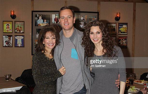 Actress Susan Lucci with son Andreas Huber and actress Alicia Minshew attend the Spontaneous Construction premiere at Guys American Kitchen Bar on...