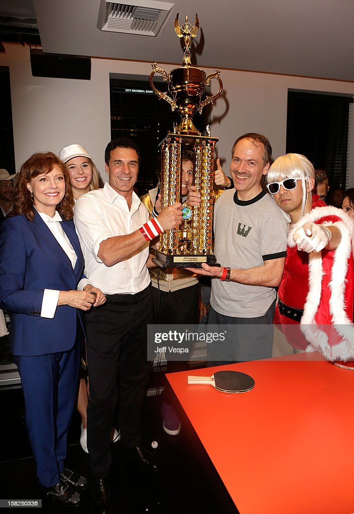 Actress Susan Sarandon, Andre Balazs, professional ping pong player Adam Bobrow, The New York Times Crossword Editor Will Shortz and professional ping pong player Kazuyuki Yokoyama attend SPiN Standard Ping Pong Social Club grand opening hosted by Susan Sarandon and Andre Balazs at The Standard, Downtown LA, on December 11, 2012 in Los Angeles, California.
