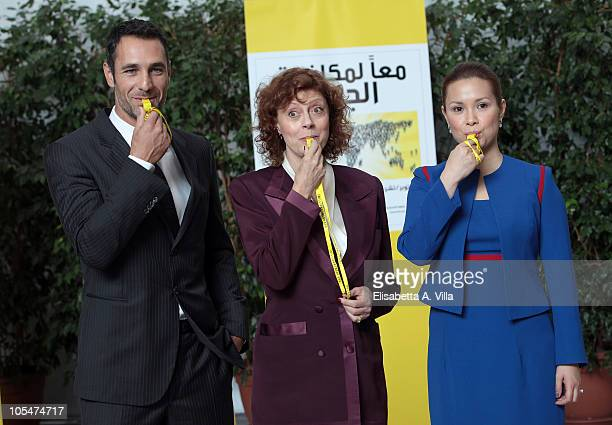 S actress Susan Sarandon blows a whistle with Italian actor Raoul Bova and Filipino singer Lea Salonga during the celebrations of World Food Day 2010...