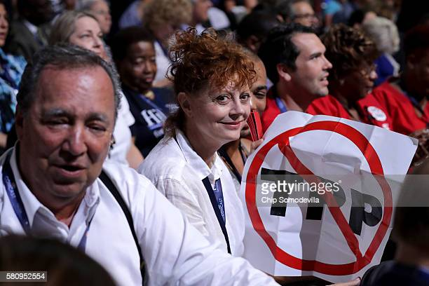 Actress Susan Sarandon holds a sign that reads 'TransPacific Partnership ' during the first day of the Democratic National Convention at the Wells...