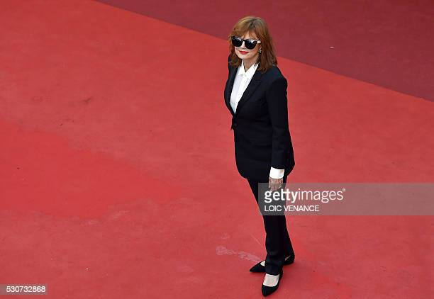 TOPSHOT US actress Susan Sarandon poses as she arrives on May 11 2016 for the opening ceremony of the 69th Cannes Film Festival in Cannes southern...