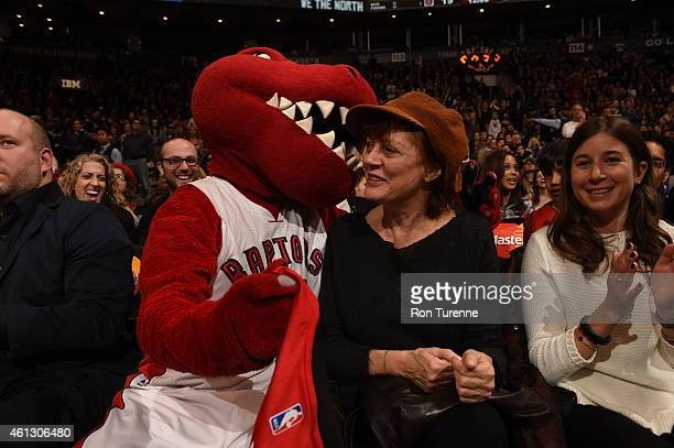 Actress Susan Sarandon poses with the Toronto Raptors mascot during the game against the Boston Celtics on January 10 2015 at the Air Canada Centre...