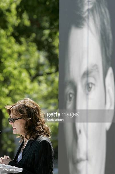 Actress Susan Sarandon speaks while standing near a picture of the late Christopher Reeve during a rally on Capitol Hill May 2 2006 in Washington DC...