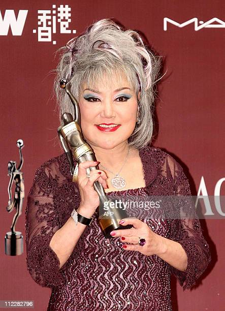 Actress Susan Shaw poses with her trophy after winning the Best New Supporting Actress award for her role in the film Gallants at the Hong Kong Film...
