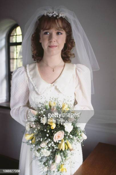 Actress Susan Tully pictured during the filming of her characters wedding scene on the set of the BBC soap opera 'EastEnders' September 29th 1986