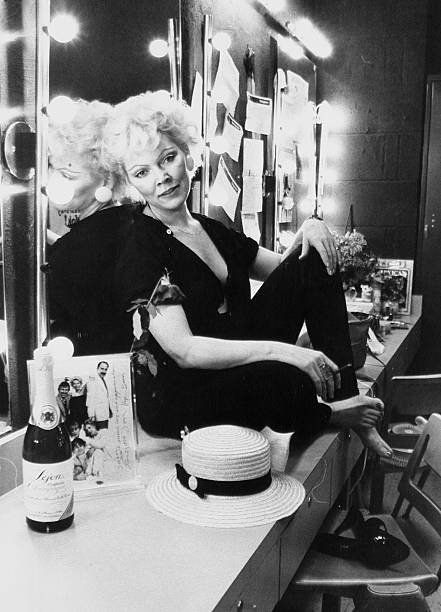 Actress Susan Tyrrell relaxes in her dressing room at the Am