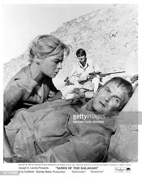 Actress Susannah York actors Stuart Whitman and Stanley Baker on set of Paramount Pictures movie Sands of the Kalahari in 1965