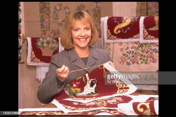 Actress Suzanne Burden embroidering at home, circa 1996.