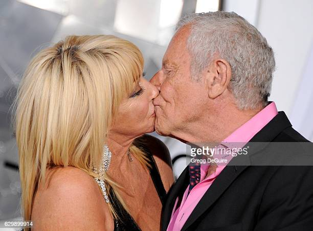Actress Suzanne Somers and husband Alan Hamel arrive at the premiere of Columbia Pictures' 'Passengers' at Regency Village Theatre on December 14...