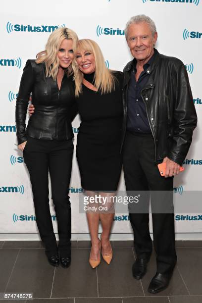 Actress Suzanne Somers and husband Alan Hamel pose for a photo with SiriusXM host Jenny McCarthy during a visit to the SiriusXM Studios on November...